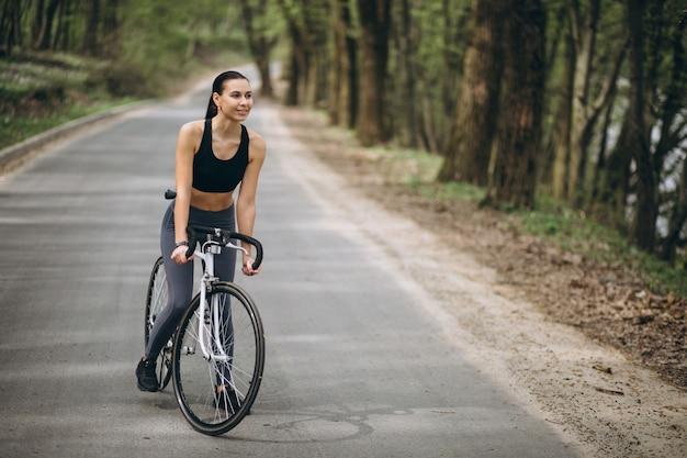 Woman biking in forest 1303 9271
