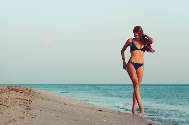 Woman in bikini on beach Premium Photo