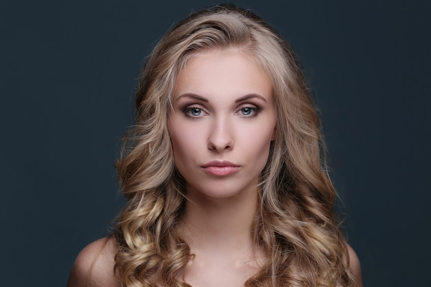 Woman in blond curly hairstyle Free Photo