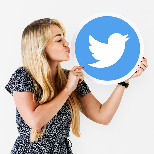 Woman blowing a kiss to a twitter icon Free Photo
