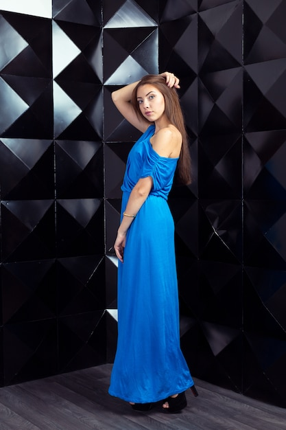 Woman in a  blue elegant dress Premium Photo