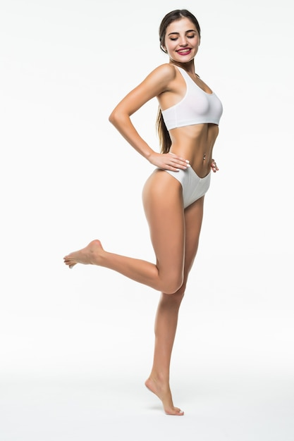 Woman body beauty, slim model walking in white underwear isolated over white wall Free Photo