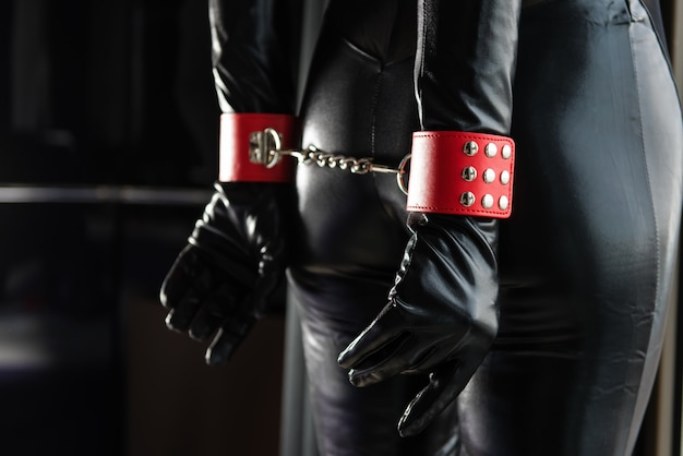 Woman body from back and red handcuffs Premium Photo