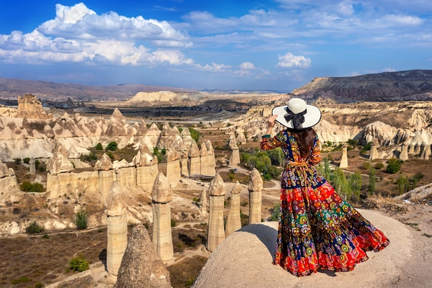 Woman in bohemian dress standing on love valley in cappadocia, turkey. Free Photo