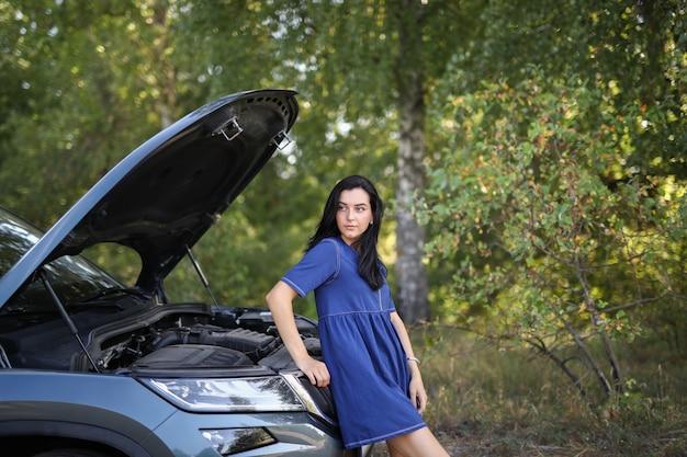 Woman in a broken car Free Photo