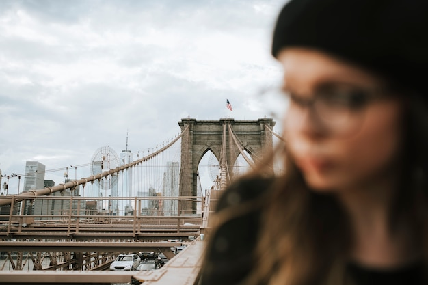Woman on the brooklyn bridge, usa Free Photo