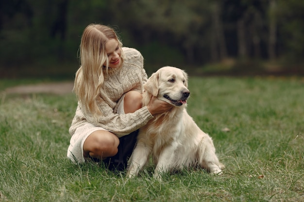 Woman in a brown sweater. lady with a labrador Free Photo