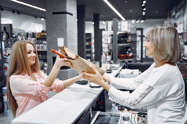 Woman buys dishes in the store Free Photo