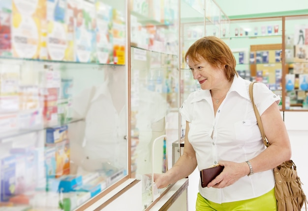 Woman buys drugs at the pharmacy Free Photo