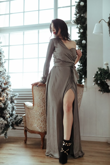 Woman by the christmas tree Free Photo