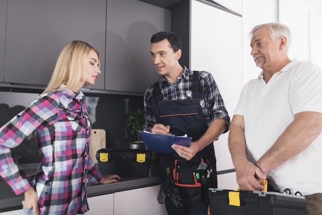 The woman called two plumbers to repair the kitchen sink Premium Photo