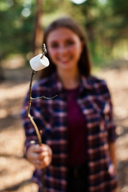 Woman camping and cooking marshmellow Free Photo