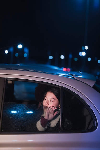 Woman in car at nicht Free Photo