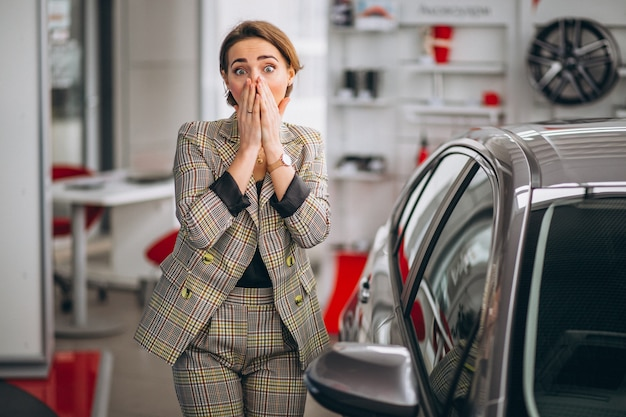 Woman in a car showroom Free Photo