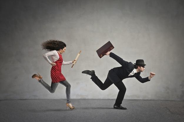 Woman chasing a man Premium Photo
