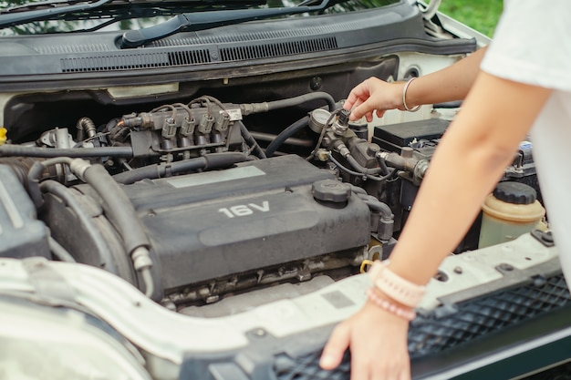 Woman checking car engine before the trip Premium Photo