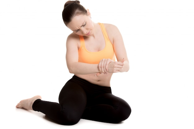 Woman checking her wrist Free Photo