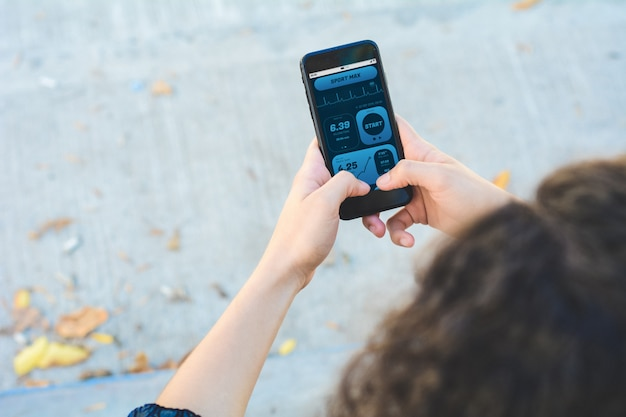 Woman checking progress with app health tracking activity on smartphone Premium Photo
