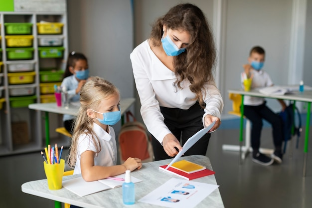 Woman checking a student's homework Free Photo