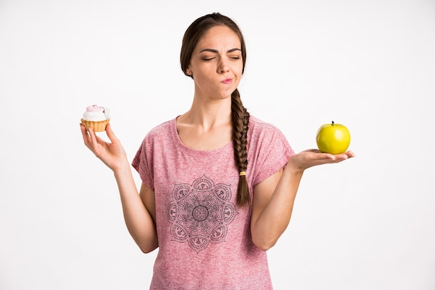 Premium Photo | Woman choosing fast or healthy food