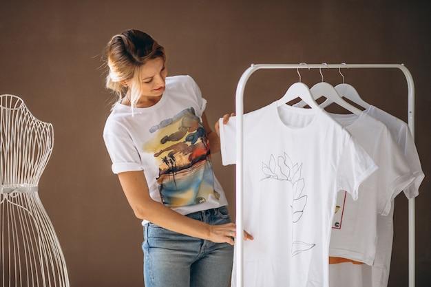 Woman chosing a white shirt Free Photo
