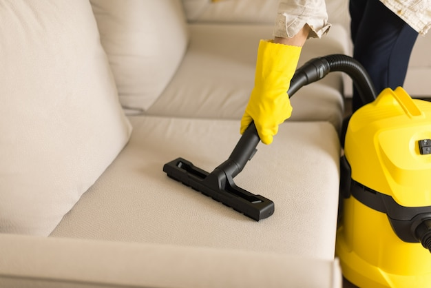 Astounding Woman Cleaning Sofa With Yellow Vacuum Cleaner Copy Space Interior Design Ideas Philsoteloinfo