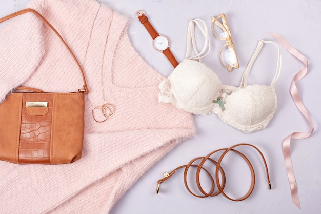Woman clothing and accessories in pastel colors Premium Photo