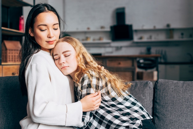 Woman comforting female friend Free Photo