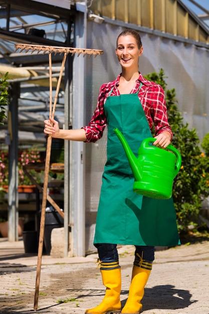 Woman commercial gardener in nursery Premium Photo