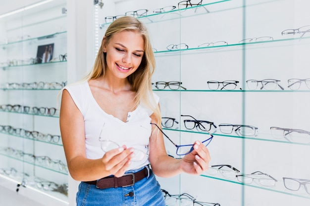 Woman comparing glasses frames Free Photo