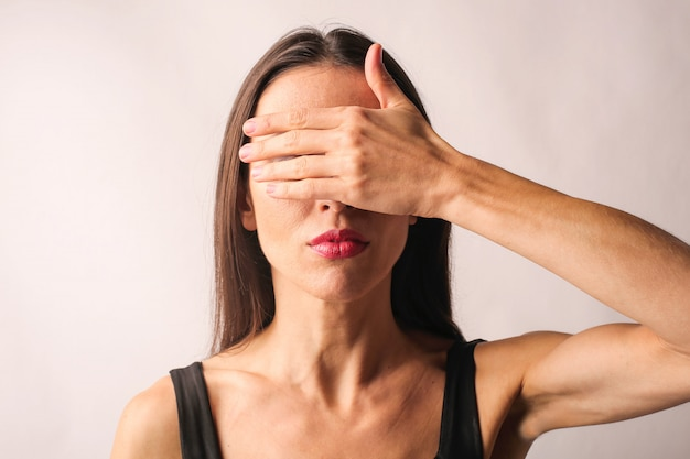 Woman covering her eyes Premium Photo