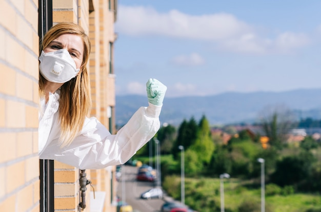 Woman covering her face with protective mask Premium Photo