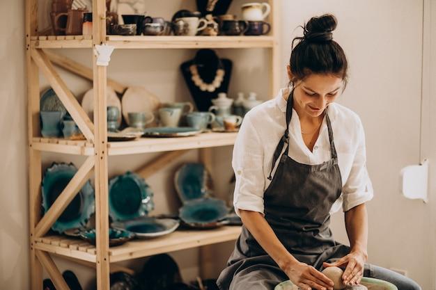 Woman craftmaster at a pottery shop Free Photo