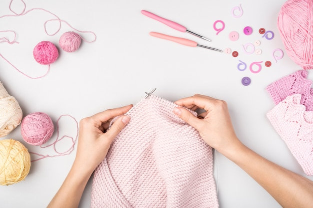 Woman crocheting with supplies near Free Photo