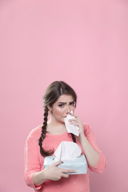 Woman crying and using box of napkins Free Photo