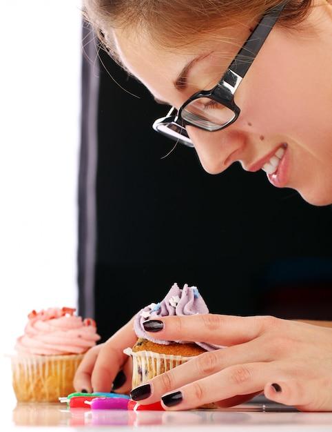 Woman and cupcake Free Photo