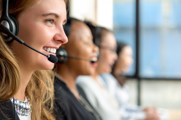 Woman customer service agents working in call center Premium Photo