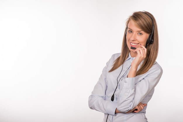 Woman customer service worker, smiling operator with phone heads Free Photo