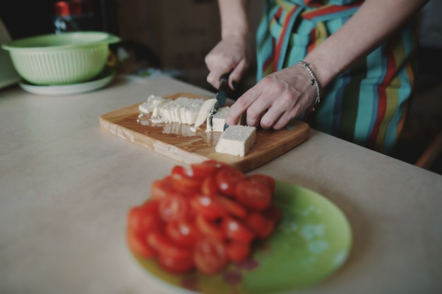 Woman cutting cheese Free Photo