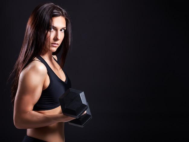 Woman demonstrates biceps Premium Photo