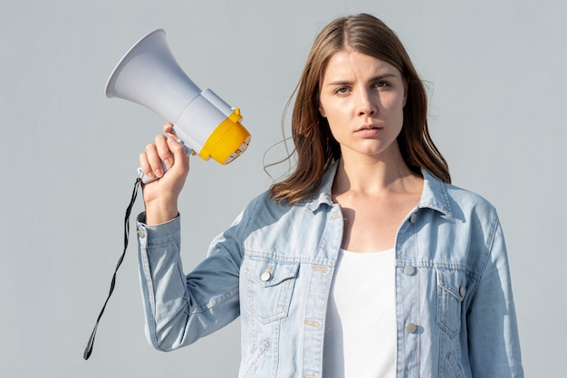Woman demonstrating for peace with megaphone Premium Photo