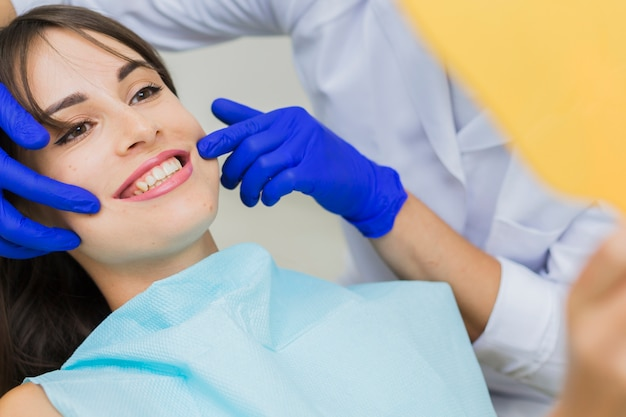 Woman at dentist smiling Free Photo