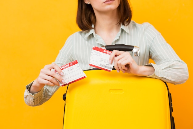 Woman destroying her plane ticket Free Photo