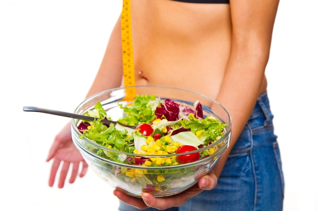 Woman in diet with salad bowl Premium Photo