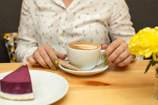 Woman dinner with cheessecake and coffee at restaurant Premium Photo