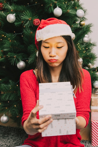 Woman disappointed with present Free Photo