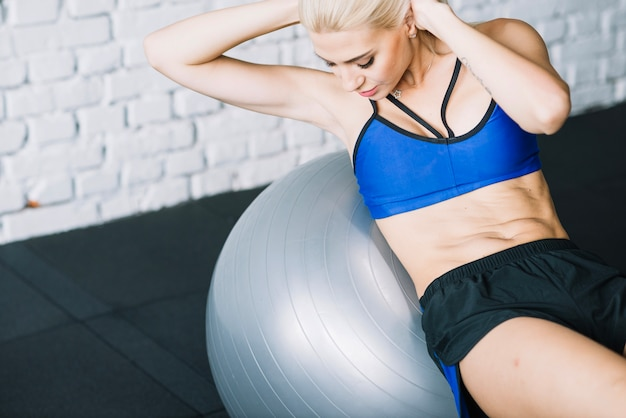 Woman doing abdominal crunches on fitball Free Photo