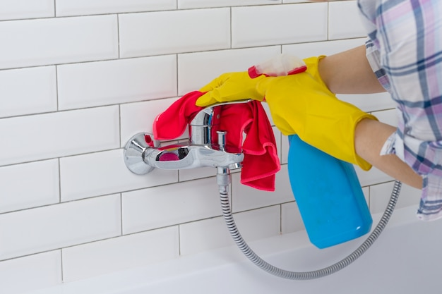 Woman doing chores in bathroom at home Premium Photo