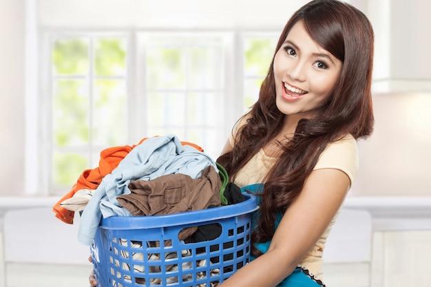 Woman doing laundry Premium Photo