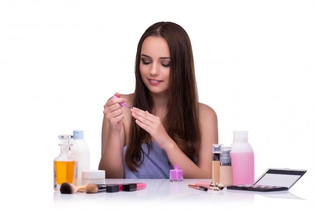 Woman doing makeup isolated on white Premium Photo